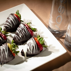 <b> Chocolate-Covered Strawberries <br/>50</b> <br/> Six Chocolate Dipped Strawberries and Two Bottles of Voss.