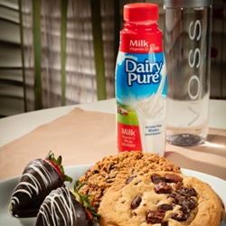 <b>Night Cap<br/>40</b> <br/>Two Chocolate-Covered Strawberries, Two Jumbo Cookies, Bottle of Milk and Bottle of Voss.