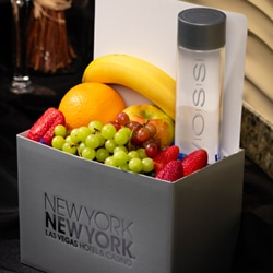 <b> Small Fruit Basket <br/>33</b> <br/> Apple, Banana, Orange, Grapes, Strawberries and a Bottle of Voss.