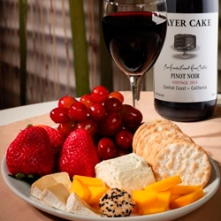 <b> Fruit & Cheese Platter Deluxe <br/>90</b> <br/>A fine selection of Brie, Goat Cheese, Boursin, Smoked Cheddar, Strawberries, Grapes, Carr's Table Water Crackers and a Bottle of White or Red Wine.