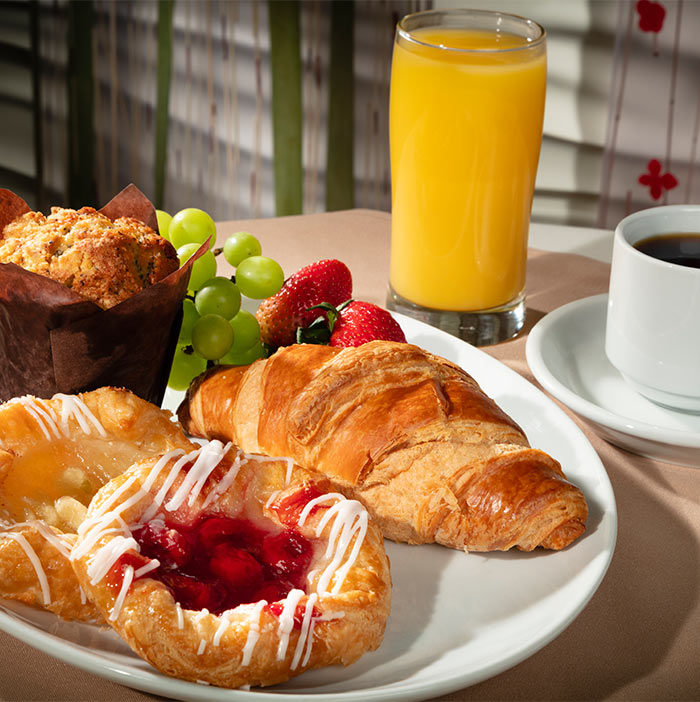 <b> Continental Wake Up   <br/> 27 </b> <br/> Muffin, Croissant, Two Danishes, Grapes, Strawberries, Pot of Coffee and Choice of Juice.