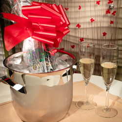 <b> Champagne for Two  <br/>60</b> <br/> Gift-Wrapped Bottle of New York-New York Champagne with New York-New York Champagne Flutes delivered on Ice with two keepsake New York-New York logo champagne flutes.